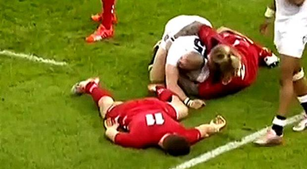 George North lays unconscious after nasty head clash against England