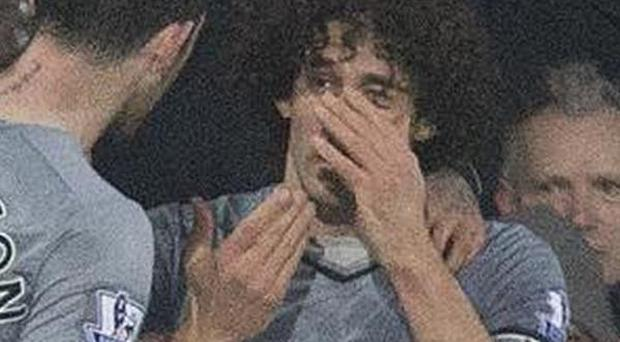 Fabricio Coloccini holds his eye after being hit by coin