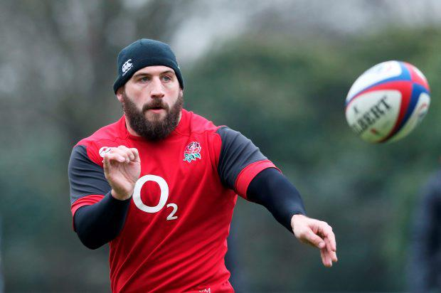 Prop Joe Marler passes the ball during the England training session