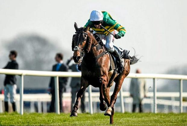Shutthefrontdoor, with Barry Geraghty up, on their way to winning the Boylesports Irish Grand National Steeplechase