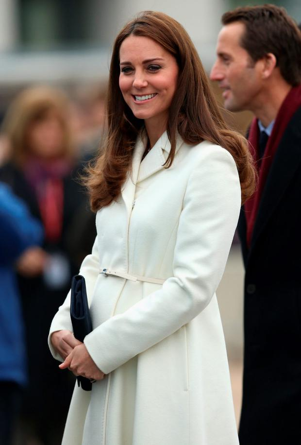 Catherine, Duchess of Cambridge laughs as she visits the home of Ben Ainslie Racing (BAR) in Portsmouth Old Town
