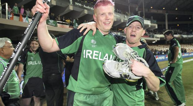 Kevin O'Brien of Ireland celebrates his historic innings alongside his brother Niall in the 2011 World Cup win against England
