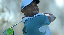 Tiger Woods grimaces as he plays a shot during last week's tournament at Torrey Pines