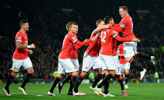 Manchester United players celebrate a goal during a Premier League game at Old Trafford this week