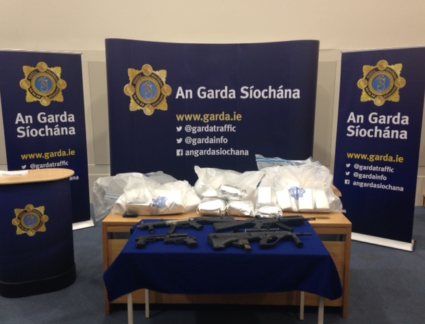 Gardai display the seized drugs and firearms.