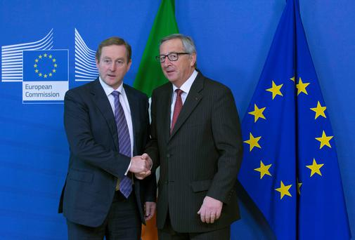 European Commission President Jean-Claude Juncker, right, welcomes Irish Prime Minister Enda Kenny ahead of a meeting at the EU Commission headquarters in Brussels (REUTERS/Yves Herman)