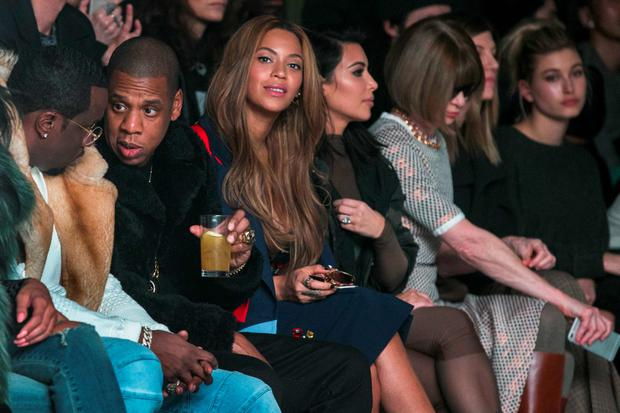Sean Combs, Jay-Z, Beyonce and Kim Kardashian sit with Vogue Editor Anna Wintour during a presentation of Kanye West's Fall/Winter 2015 partnership with Adidas at New York Fashion Week February 12, 2015. REUTERS/Lucas Jackson