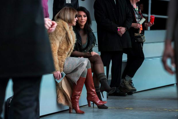 Kim Kardashian talks with Anna Wintour before watching a presentation of Kanye West's Fall/Winter 2015 partnership with Adidas at New York Fashion Week February 12, 2015. REUTERS/Lucas Jackson