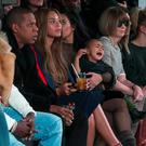 Kim Kardashian attempts to calm her daughter, North, while sitting next to Sean Combs, Jay-Z), Beyonce and Anna Wintour as they watch a presentation of Kanye West's Fall/Winter 2015 partnership with Adidas at New York Fashion Week REUTERS/Lucas Jackson