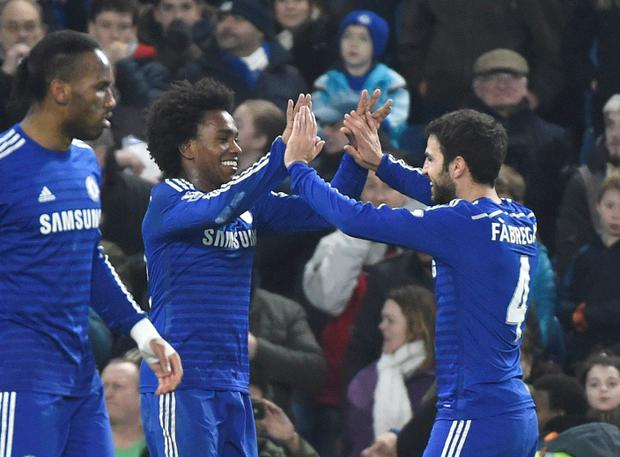 Willian (L) of Chelsea celebrates scoring with Cesc Fabregas