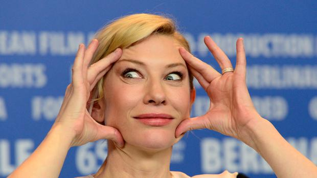 Cate Blanchett gestures as she attends a press conference for the film