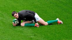 13 February 2015; Ireland's Jonathan Sexton stretches before training during the captain's run. Aviva Stadium, Lansdowne Road, Dublin. Picture credit: Matt Browne / SPORTSFILE