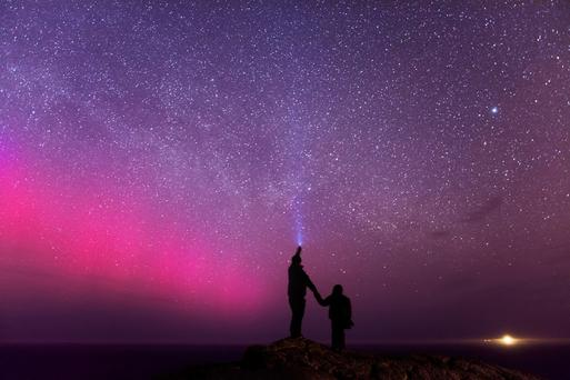 Aurora Borealis, Malin Head. 'Myself and my eldest son were lucky to observe the Northern Lights in April 2014, a small display that lasted no longer than 15 mins. This is a photo close to my heart, as the lighthouse in the distance (Inishtrahull) is where my great grandmother was born. Photo: Ronan McLaughlin