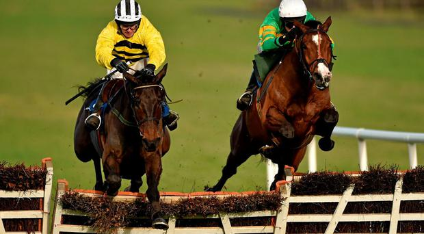 Kitten Rock, right, with Mark Walsh up, jumps the last ahead of Glens Melody, with David Casey up, on their way to winning the Limestone Lad Hurdle
