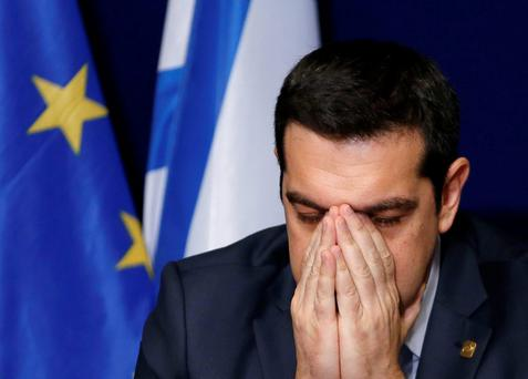 Greece's Prime Minister Alexis Tsipras shows the strain this week as he addresses a news conference after a European Union leaders summit in Brussels.