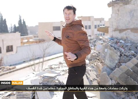 British hostage John Cantlie, in an Isil video grab, whom has told his family that it is unlikely that they will ever see him alive again