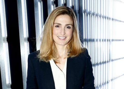Julie Gayet is receiving protection from Francois Hollande's personal bodyguard and another security agent, leading to claims the actress is being treated as France's 'first lady'