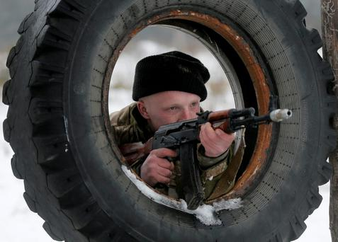 A newly mobilized Ukrainian soldier shows his skills during military drills in base Desna 100km north from Kiev, Ukraine. Fierce fighting surged in east Ukraine as Russian-backed separatists mounted a major and sustained new push to capture a strategic railway hub ahead of a weekend cease-fire deadline.