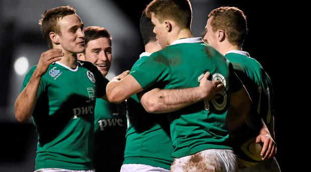 13 February 2015; Ireland's Garry Ringrose, 13, is congratulated by team-mates after scoring his side's fourth try of the game. U20's Six Nations Rugby Championship, Ireland v France, Dubarry Park, Athlone, Co. Westmeath. Picture credit: Ramsey Cardy / SPORTSFILE