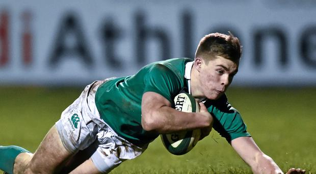 Ireland's Garry Ringrose dives over to score his side's fourth try of the game