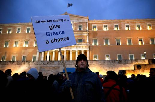 A man takes part in a anti-austerity pro-government demo in front of the parliament in Athens. Reuters