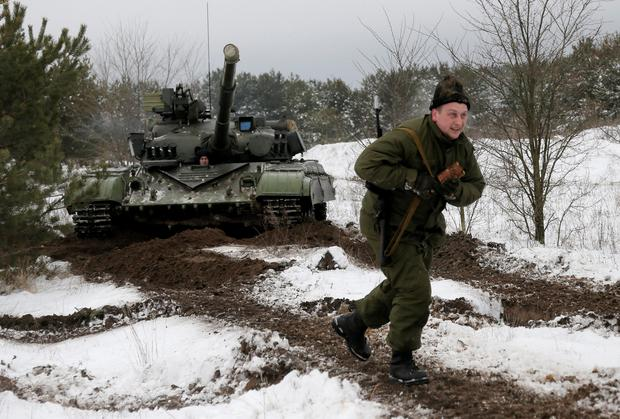 A newly mobilized Ukrainian soldier shows his skills during military drills at a base in Desna 100km north from Kiev