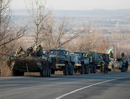 Members of the Ukrainian armed forces ride on military vehicles near Artemivsk, eastern Ukraine
