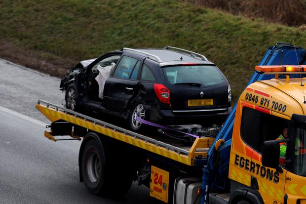 Cars are removed from a multiple car crash on the M40 motorway near Bicester, Oxfordshire (Steve Parsons/PA Wire)
