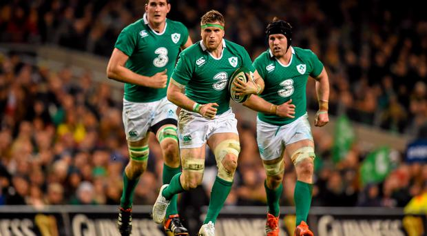 14 February 2015; Jamie Heaslip, Ireland, supported by teammates Devin Toner, left, and Sean O'Brien. RBS Six Nations Rugby Championship, Ireland v France. Aviva Stadium, Lansdowne Road, Dublin. Picture credit: Stephen McCarthy / SPORTSFILE