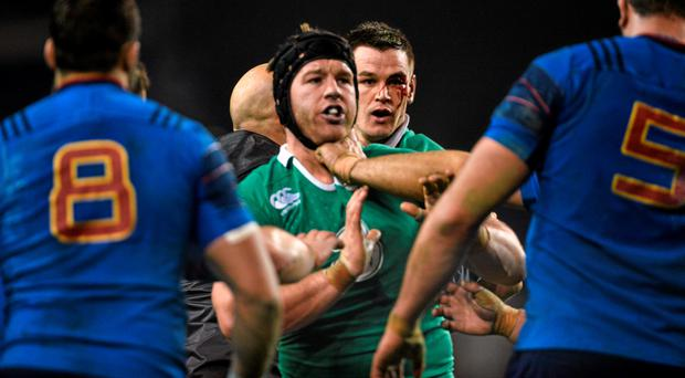 Jonathan Sexton, Ireland, looks on behind teammate Sean O'Brien after picking up a blood injury