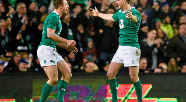Ireland's Jonathan Sexton, right, and Tommy Bowe celebrate Ireland's victory against France