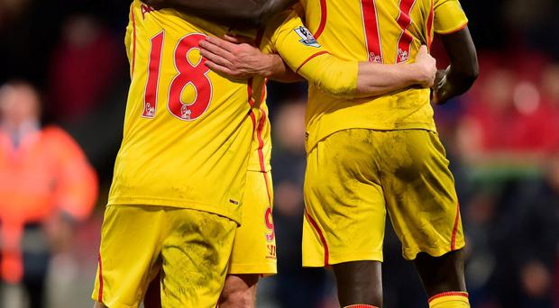 LONDON, ENGLAND - FEBRUARY 14: Rickie Lambert hugs Alberto Moreno and Mamadou Sakho of Liverpool after the FA Cup fifth round match between Crystal Palace and Liverpool at Selhurst Park on February 14, 2015 in London, England. (Photo by Jamie McDonald/Getty Images)