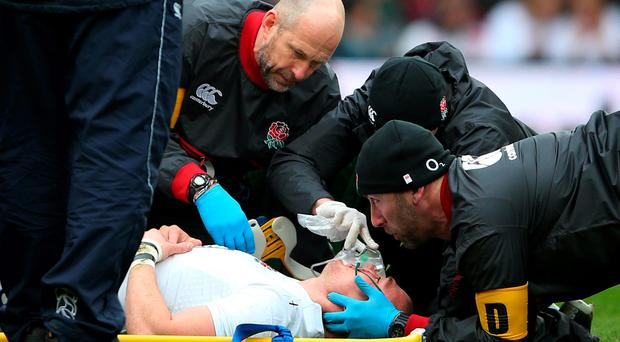 Mike Brown receives treatment on the pitch during yesterday's match