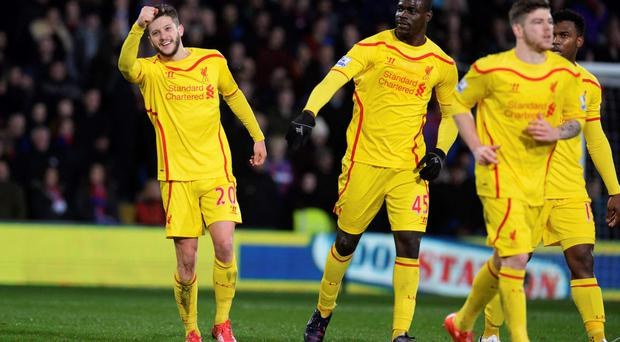 Liverpool's Adam Lallana (L) celebrates after scoring a goal against Crystal Palace during the FA Cup fifth round soccer match at Selhurst Park in London February 14, 2015. REUTERS/Philip Brown (BRITAIN - Tags: SPORT SOCCER)