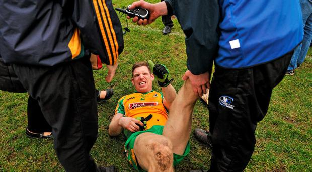 Corofin's Kieran McGrath gives the thumbs up while receiving treatment for cramp at the end of the match