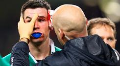 Jonathan Sexton, scorer of five penalties in Ireland's win over France, is treated for a nasty blood injury after a clash of heads with France's Mathieu Bastareaud.