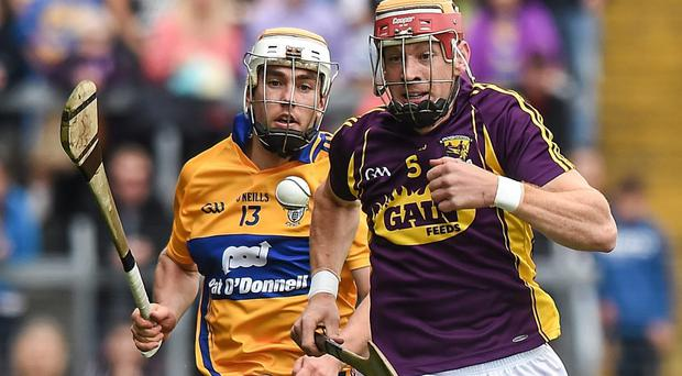 Andrew Shore, Wexford, races clear of Conor McGrath, Clare