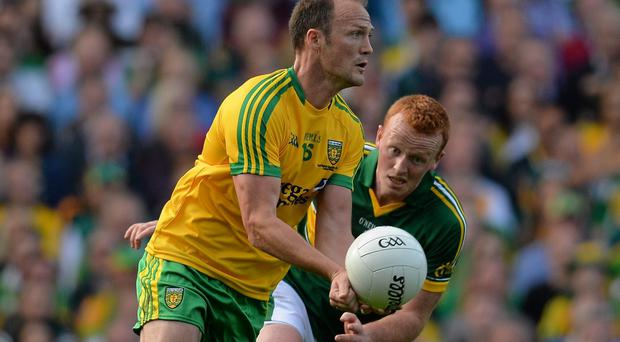 Colm McFadden, Donegal,with a handpass in the All Ireland Senior Championship Final against Kerry