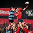 Billy Holland, Munster, takes the ball in the lineout ahead of Macauley Cook, Cardiff Blues