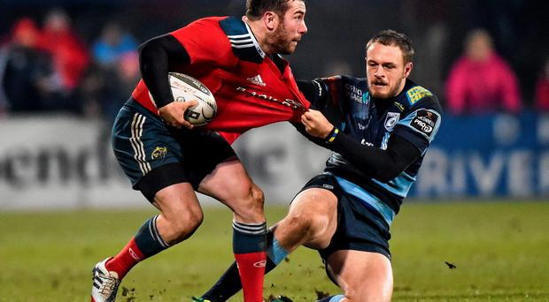 JJ Hanrahan, Munster, is tackled by Cory Allen, Cardiff Blues
