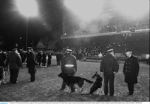 15 February 1995; Gardai patrol the pitch as supporters leave the ground after rioting broke out in the Upper West Stand which resulted in the game being abandoned. International Friendly, Republic of Ireland v England, Lansdowne Road, Dublin. Picture credit; David Maher / SPORTSFILE
