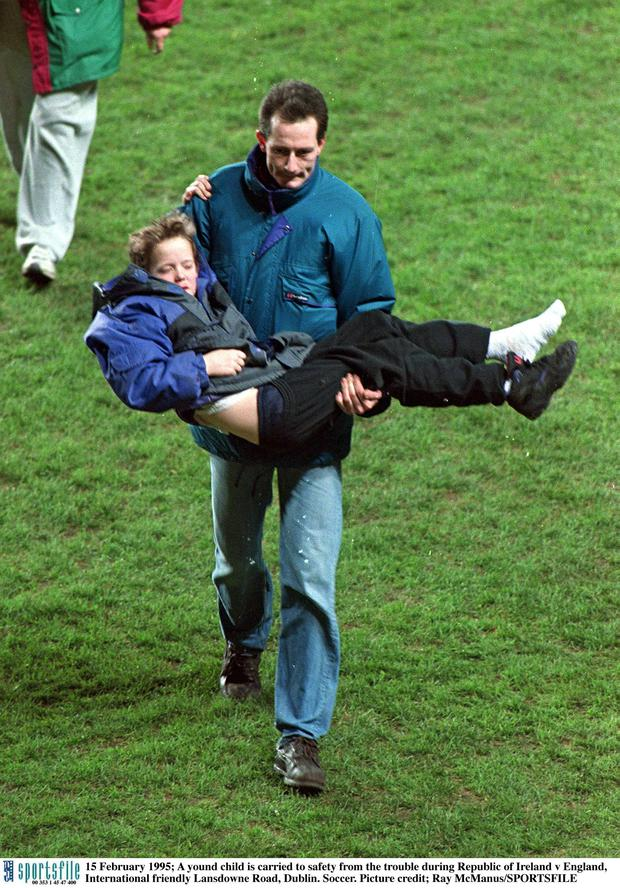 15 February 1995; A young child is carried to safety after rioting broke out in the Upper West Stand forcing the abandonment of the game. International Friendly, Republic of Ireland v England, Lansdowne Road, Dublin. Picture credit; Ray McManus / SPORTSFILE