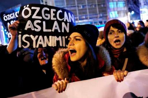 A woman shouts slogans during a demostration in Istanbul