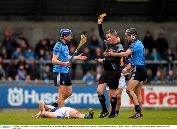 15 February 2015; Dublin's Conal Keaney is shown a yellow card by referee Barry Kelly after a tumble over Shane McGrath, Tipperary. Allianz Hurling League, Division 1A, Round 1, Dublin v Tipperary, Parnell Park, Dublin. Picture credit: Ray McManus / SPORTSFILE