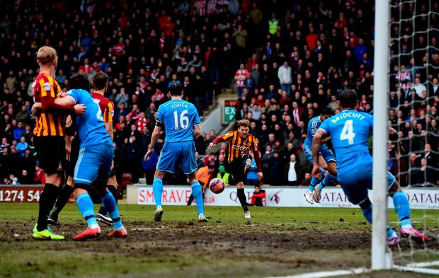 BRADFORD, ENGLAND - FEBRUARY 15: Billy Clarke of Bradford shoots at goal before his shot defelcts off John O'Shea of Sunderland and into his own net for the opening goal during the FA Cup Fifth Round match between Bradford City and Sunderland at Coral Windows Stadium, Valley Parade on February 15, 2015 in Bradford, England. (Photo by Laurence Griffiths/Getty Images)