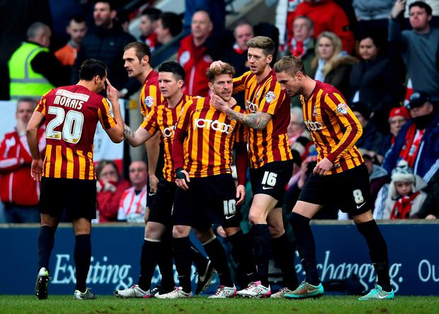 BRADFORD, ENGLAND - FEBRUARY 15: Braddford players celebrate after John O'Shea of Sunderland scored an own goal during the FA Cup Fifth Round match between Bradford City and Sunderland at Coral Windows Stadium, Valley Parade on February 15, 2015 in Bradford, England. (Photo by Laurence Griffiths/Getty Images)