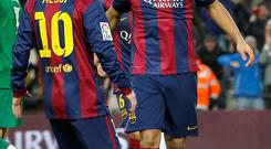 Barcelona's Luis Suarez celebrates his goal with teammate Lionel Messi (L) during their Spanish first division soccer match against Levante at Nou Camp stadium in Barcelona February 15, 2015. REUTERS/Gustau Nacarino (SPAIN - Tags: SPORT SOCCER)