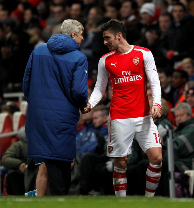 Arsenals French striker Olivier Giroud (R) shakes hands with Arsenals French manager Arsene Wenger (L) as he leaves the field after being substituted during the English FA Cup fifth round football match between Arsenal and Middlesbrough at the Emirates Stadium in London on February 15, 2015. AFP PHOTO / IAN KINGTON RESTRICTED TO EDITORIAL USE. No use with unauthorized audio, video, data, fixture lists, club/league logos or live services. Online in-match use limited to 45 images, no video emulation. No use in betting, games or single club/league/player publications.IAN KINGTON/AFP/Getty Images