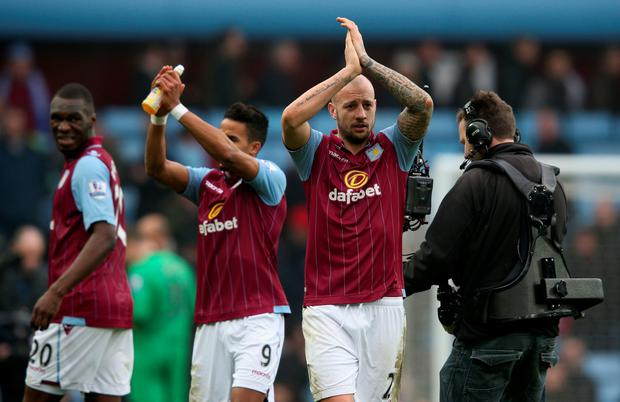 BIRMINGHAM, ENGLAND - FEBRUARY 15: Alan Hutton of Aston Villa (R) applauds the fans after the FA Cup fifth round match between Aston Villa and Leicester City at Villa Park on February 15, 2015 in Birmingham, England. (Photo by Clive Mason/Getty Images)