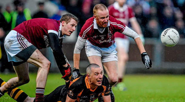 Kieran Donaghy, Austin Stacks, under pressure from Slaughtneil players Brendan Rogers, left, and Conan Cassidy